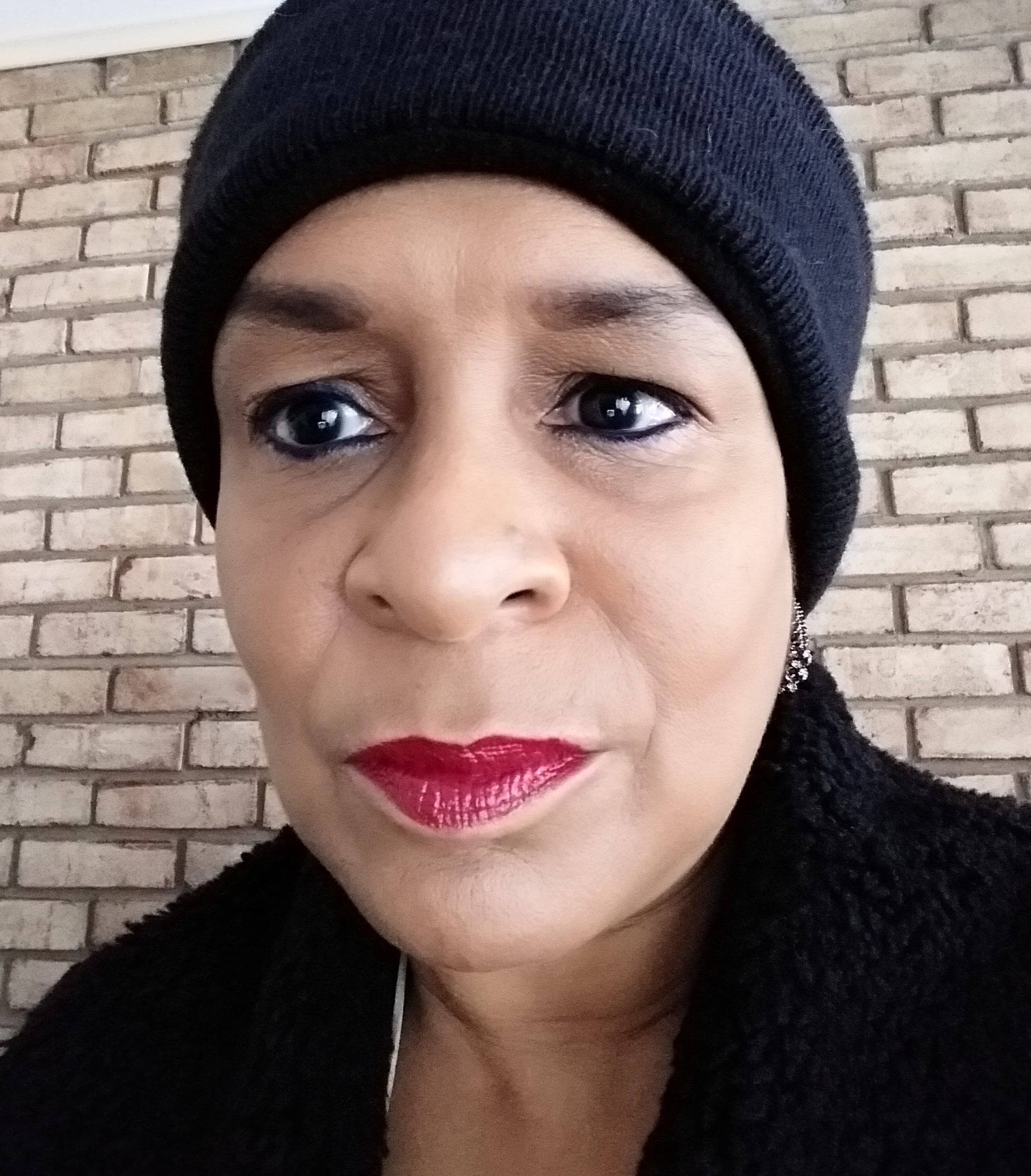 Talk about misunderstanding. This featured image is a selfie of me weaing a black knit headband and furry sweater. I'm also wearing bright red lipstick and to many people I don't look blind.